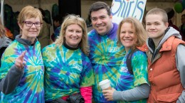 Smiling in their matching tie-dye shirts are, left to right, Minute Man Arc CEO Jean Goldsberry, Sharon Spaulding of the Concord Lions, Concord Police Chief Joseph O'Connor, Leigh Ann Crimmings and Haley Crimmings. Courtesy photos / Lou Genovese