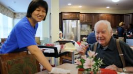 Laura Johnson assists a resident of Robbins Brooks where she volunteers every Tuesday.